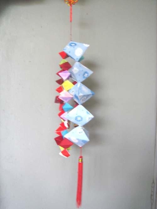 长方形纸折粽子的折法步骤图解